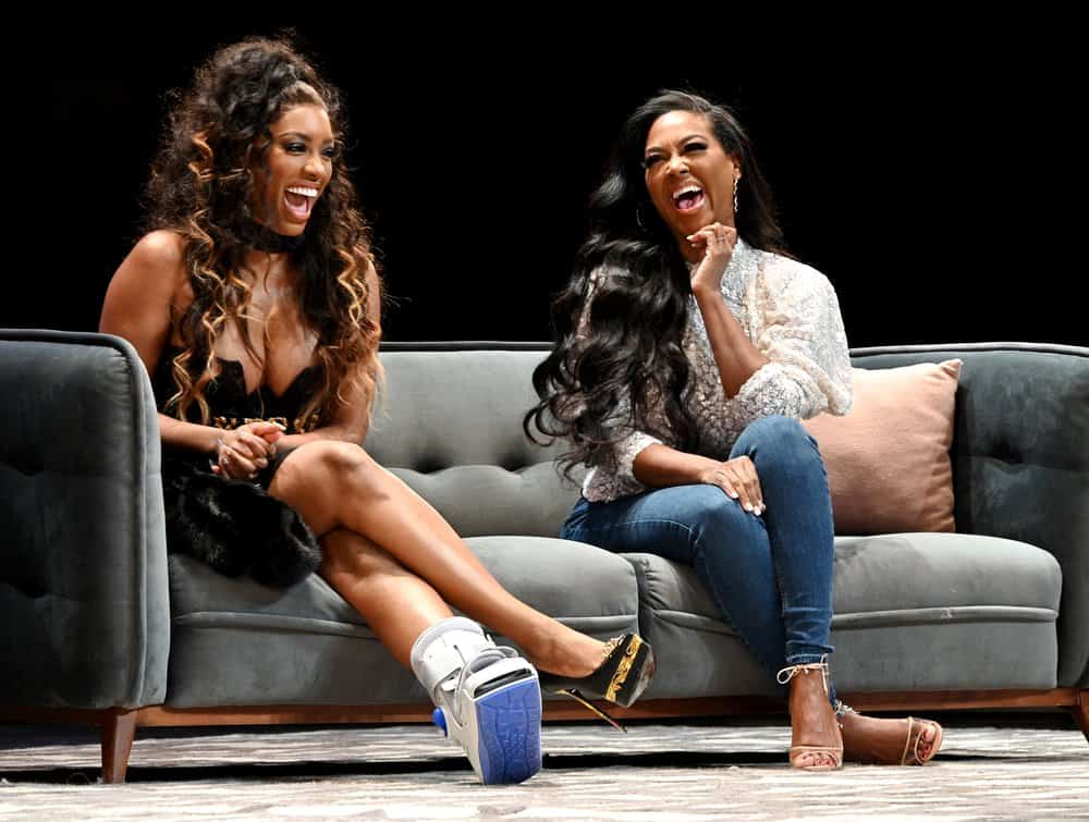 Porsha Williams and Kenya Moore on stage at BravoCon