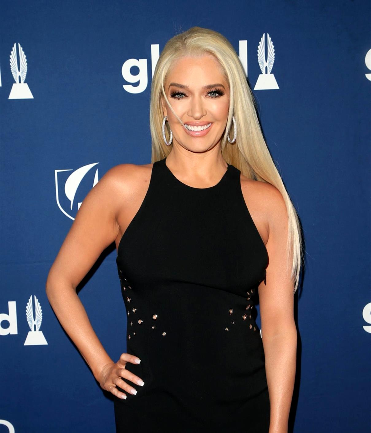 """PHOTOS: RHOBH's Erika Jayne Boards a Private Jet Amid Legal Drama, Claps Back at Fan Who Tells Her to """"Read the Motherf-cking Room"""""""